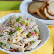 Tuna penne pasta salad served in a white bowl.