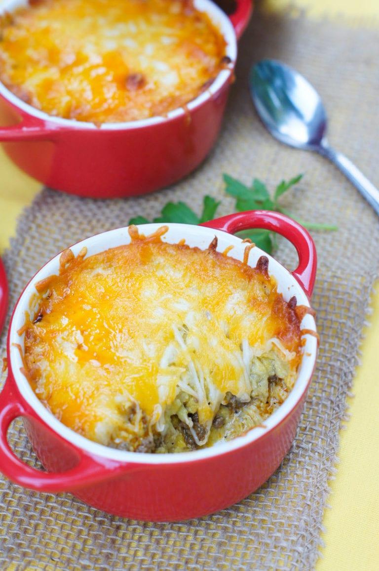 Plantain and picadillo casserole in a red bowl.