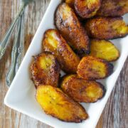 Fried sweet plantains served on a white plate