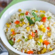 Close up of white rice with corn and peppers.