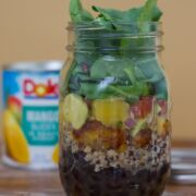 The quinoa salad layered in a glass jar.